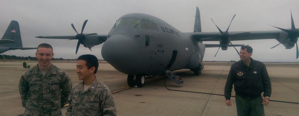 UConn cadets next to an Air Force airplane